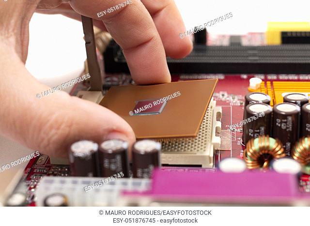 Close up view of the mounting of a cpu on motherboard