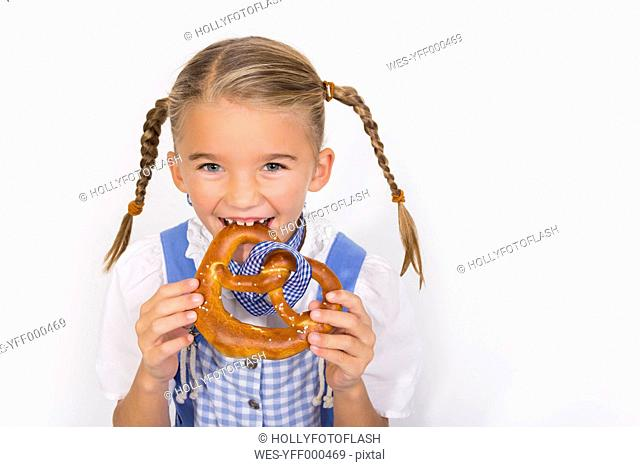 Portrait of little girl eating pretzel