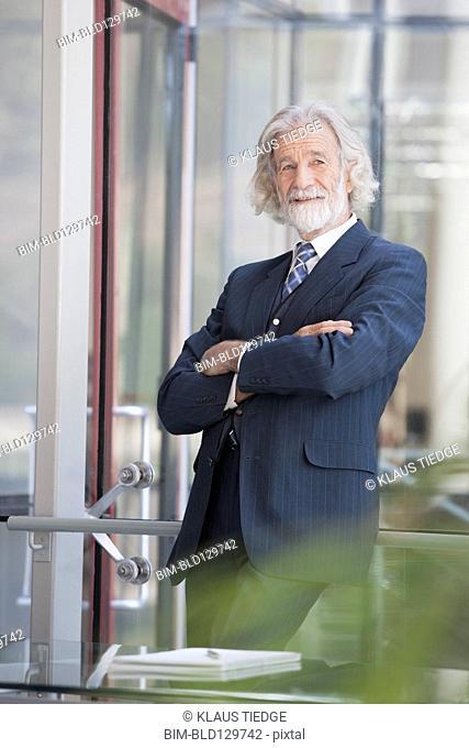 Senior Caucasian businessman smiling in office