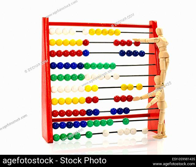 two wooden puppet in teamwork on the abacus