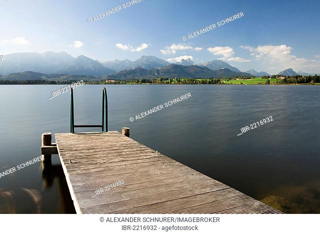 Jetty on lake Hopfensee, Allgaeu Alps at the back, Hopfen am See, Ostallgaeu, Bavaria, Germany, Europe