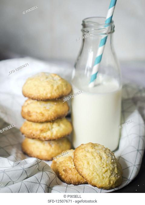 Lemon and coconut biscuits served with a bottle of milk