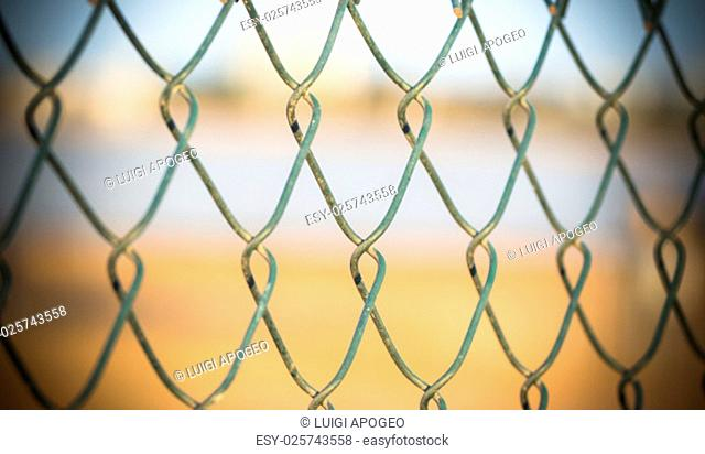 embroidery of a metal fence. In fronte of a metal industrial fence