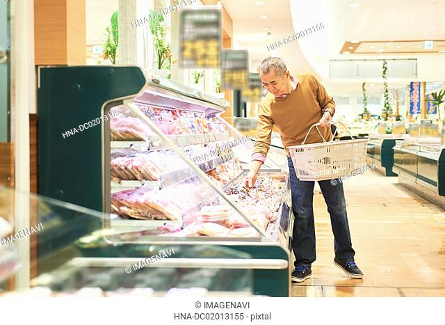 Senior man shopping in supermarket