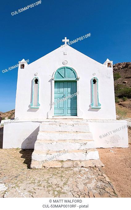 White church in rural landscape