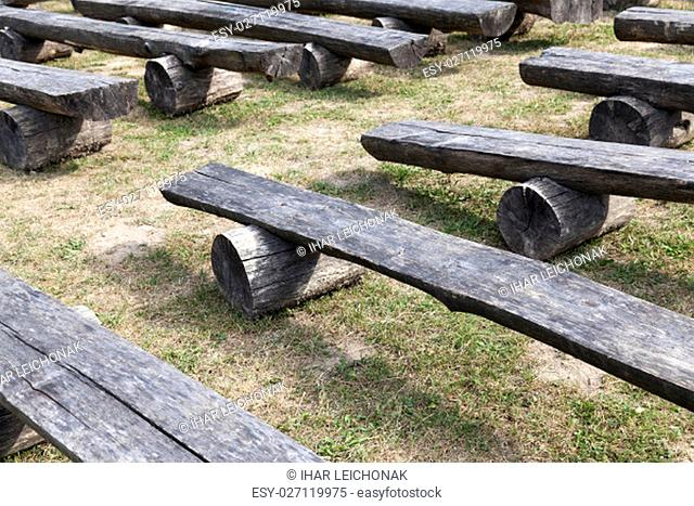 photographed close-up old wooden benches placed in the park