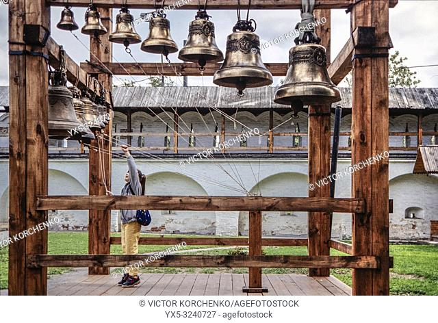 Girl ringing the bells of Andronikov monastery in Moscow