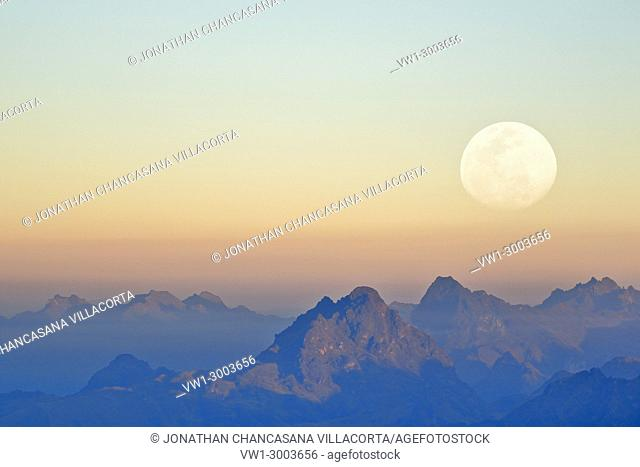Mountains at sunset seen from the snowy Huaytapallana next to the moon, photography achieved thanks to the use of double exposure from the camera