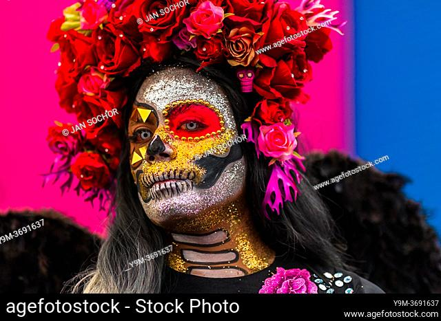 A young Mexican woman, dressed as La Catrina, a Mexican pop culture icon representing the Death, takes part in the Day of the Dead festivities in Oaxaca, Mexico