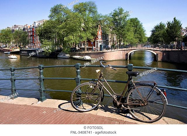 Bicycle on a bridge in Amsterdam, Netherlands