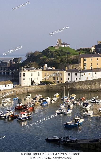 UK, Wales, Pembrokeshire, Tenby, colourful buildings around the harbour in autumn sunshine