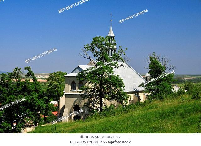 The Parish Church of St Bartholomew is located at the rock terrace cut in the slope of the Zamkowa Mountain in Chentshin, Swietokrzyskie Voivodeship, Poland