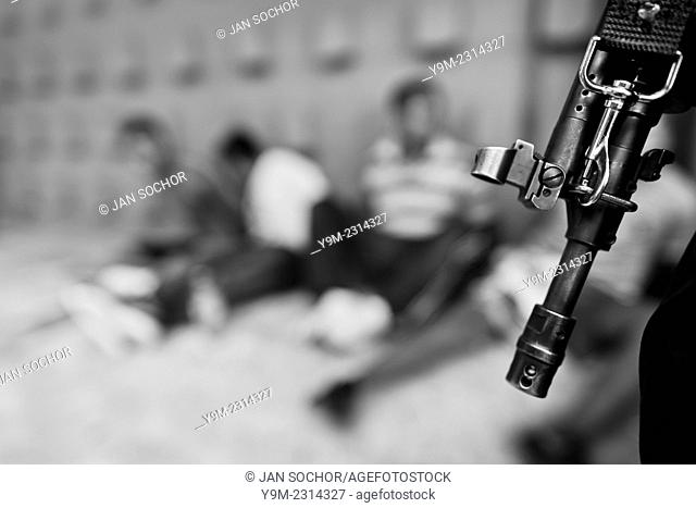 The supposed Mara Salvatrucha gang members, detained by the Police emergency unit (Halcones), are seen on the yard of a detention center in San Salvador