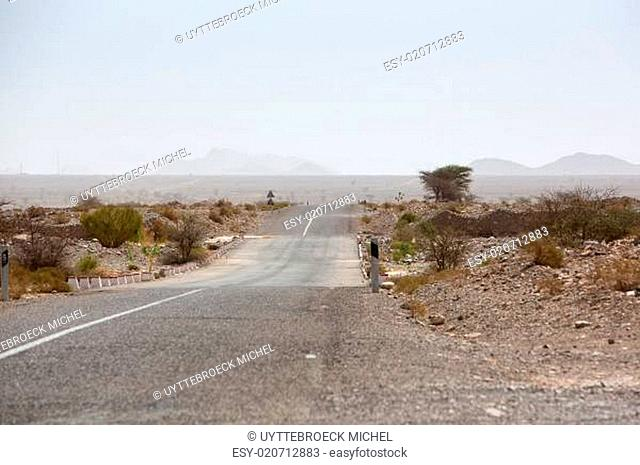 Straight road through the desert in Morocco, Africa