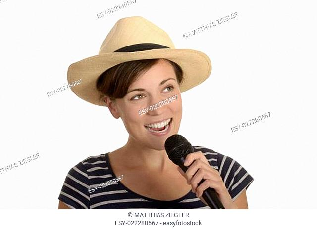pretty young girl singing with microphone and hat