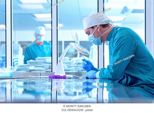 Workers inspecting surgical instruments in clean room of surgical instruments factory