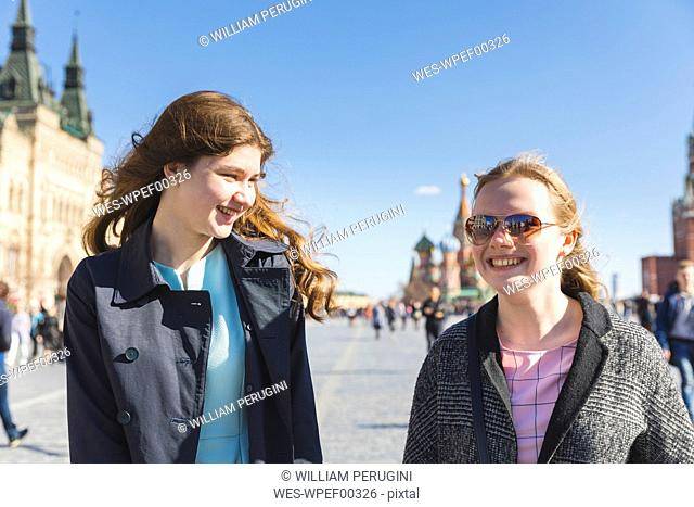 Russia, Moscow, teenage girls visiting the Red Square in the city