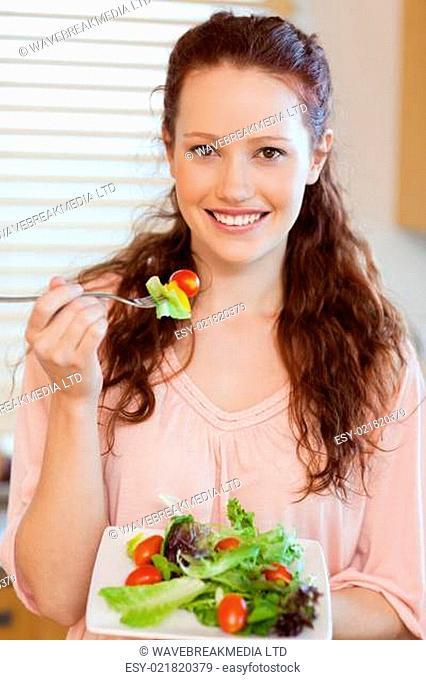Girl eating salad