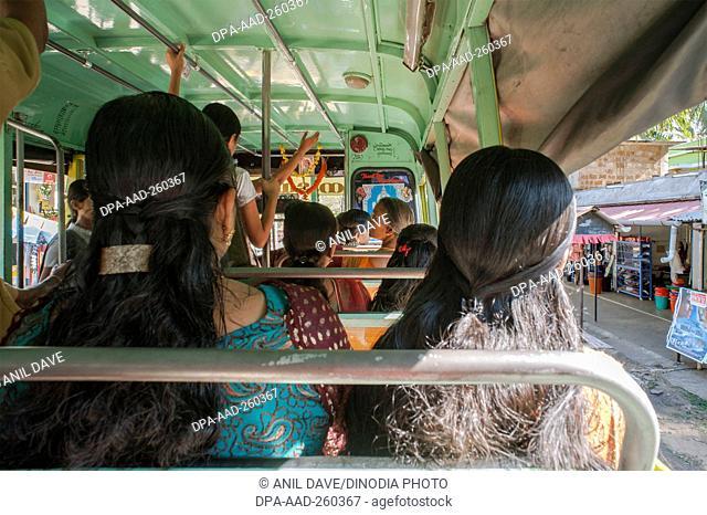 woman sitting in bus, Palayoor, Kerala, India, Asia