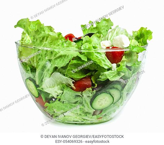 Mixed salad in a glass bowl on a white background