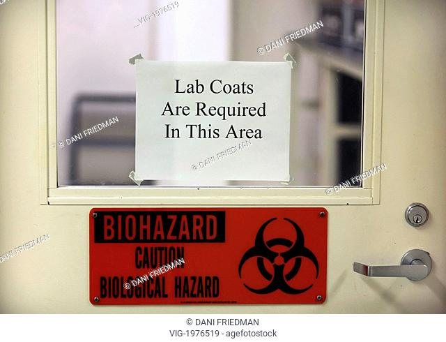 CANADA, EDMONTON, 11.05.2009, A biohazard warning sign on a door. - EDMONTON, ALBERTA, CANADA, 11/05/2009