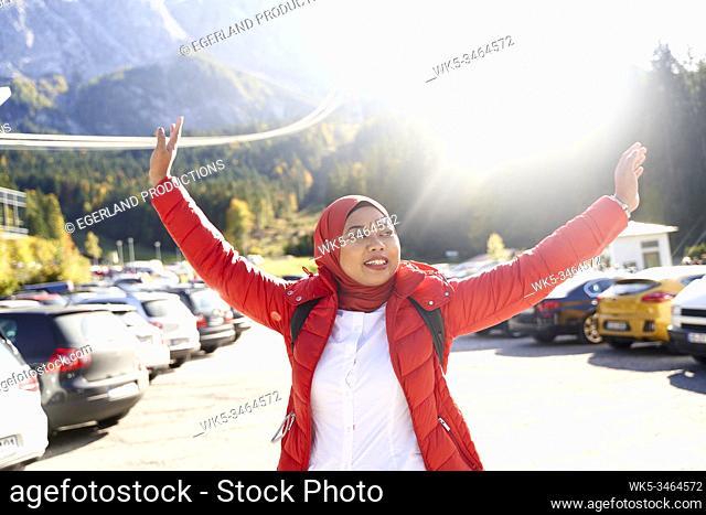 Asian woman with hijab, enjoying trip to nature. Eibsee, Bavaria, Germany