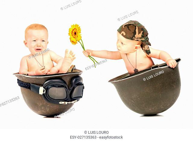 Cute baby girl duplicated inside an old military helmet