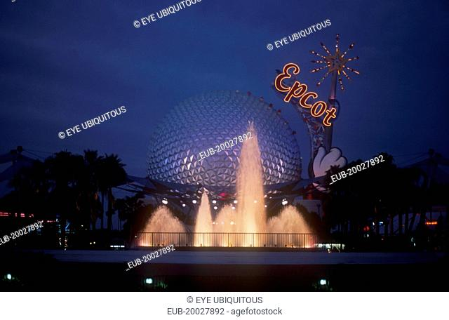 Walt Disney World Epcot. View of the Spaceship Earth with Epcot sign and fountain illuminated at dusk