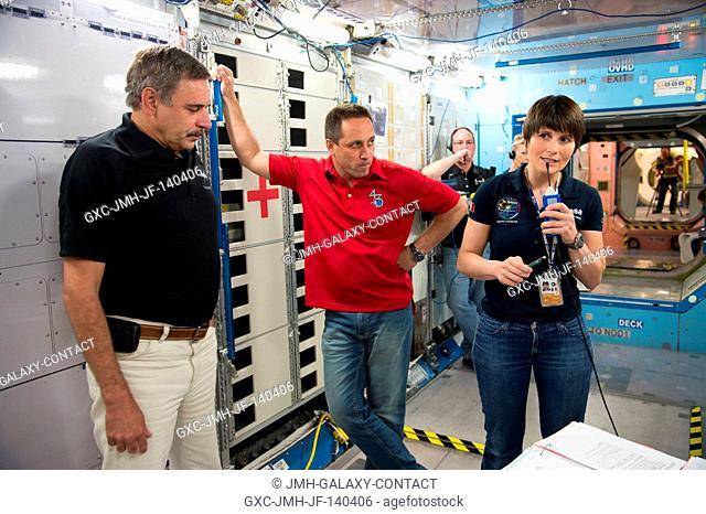Russian cosmonaut Mikhail Kornienko (left), Expedition 43-46 flight engineer; Russian cosmonaut Anton Shkaplerov and European Space Agency astronaut Samantha...