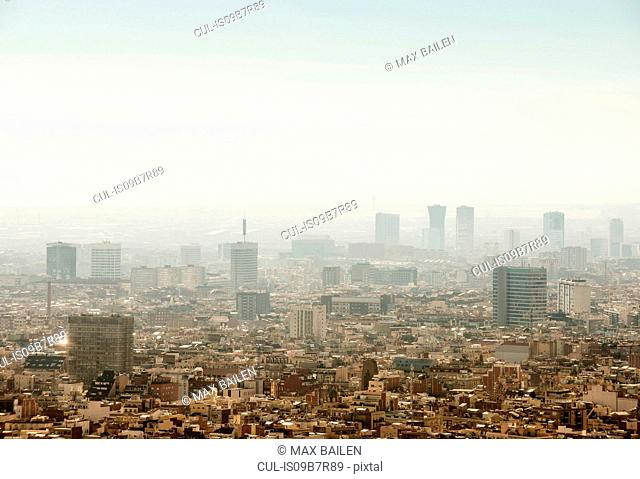 Elevated hazy cityscape view with skyscrapers, Barcelona, Spain