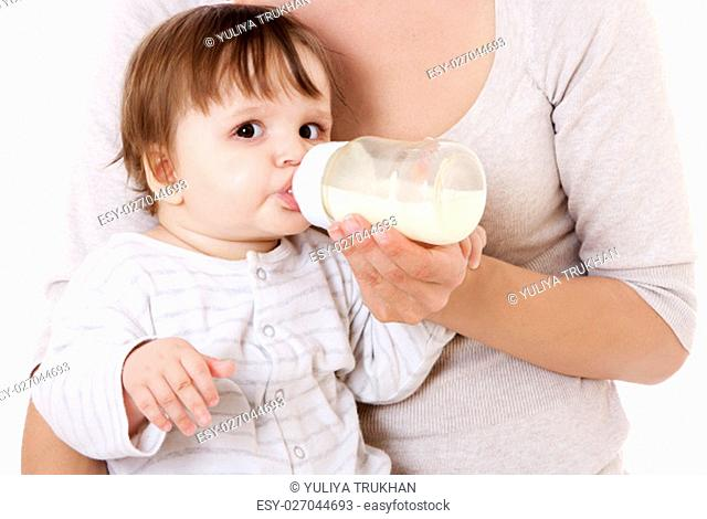 Mother feeding her newborn baby with the bottle. Isolsted on white