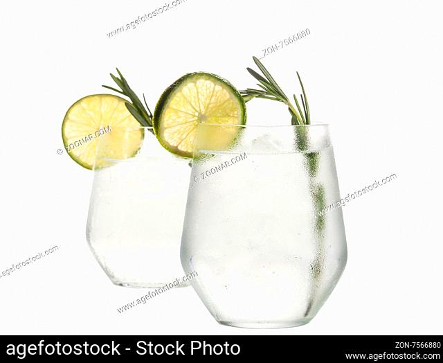 Glass with alcoholic drink with lime and ice isolated on white background