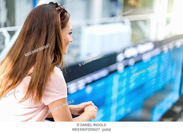 Brunette woman leaning on railing