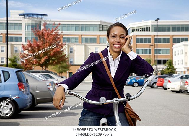 African American woman sitting on bicycle