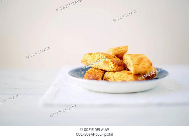 Still life of almond cantucci biscuits on plate