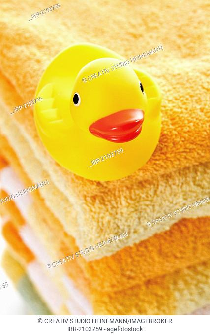Rubber duck on a stack of towels