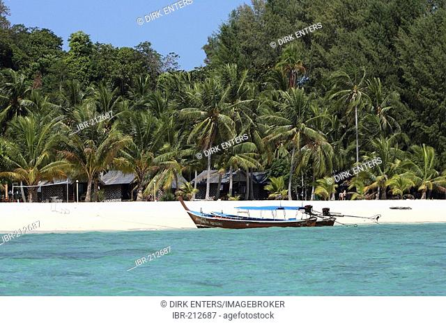 Longtail boat in front of sandy beach of the island Koh Lipe inside Tarutao National Park - Andaman Sea, Thailand, Asia