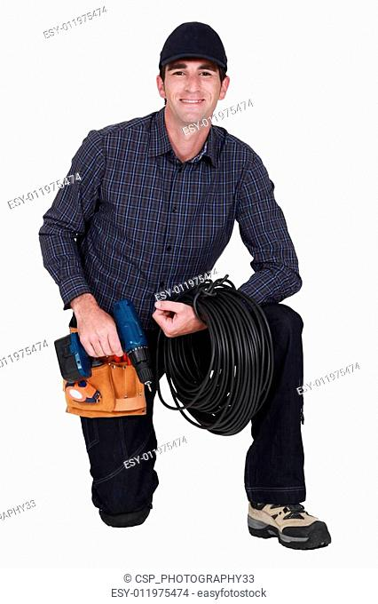 A kneeled electrician