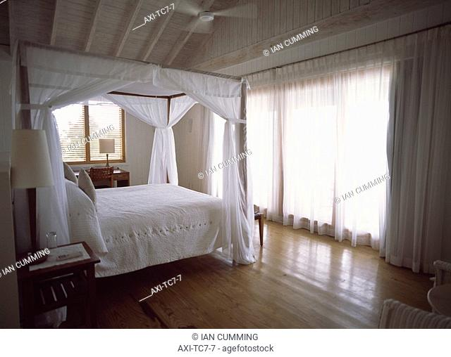 Bedroom of a private villa, Parrot Cay, Turks and Caicos Islands
