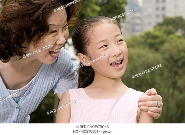 Close-up of a mature woman smiling with her granddaughter