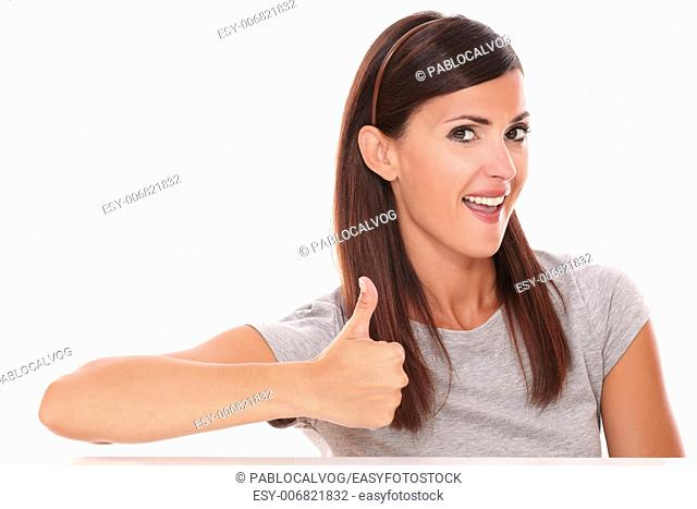 Front view portrait of cute female with ok sign looking at you on isolated white background