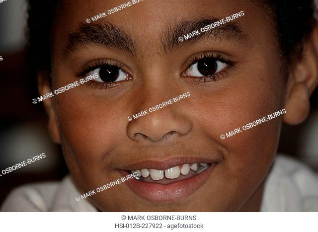 Close-up portrait of young boy 8 years