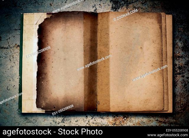 Old books on the background of concrete and dirt