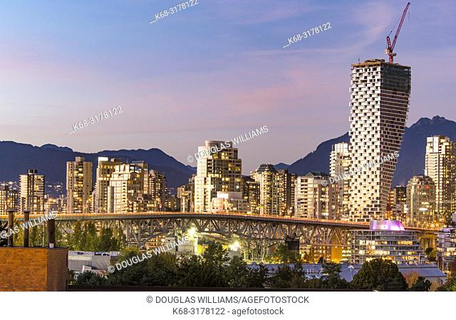 Skyline at twilight, with Vancouver House tower on right, Vancouver, BC, Canada