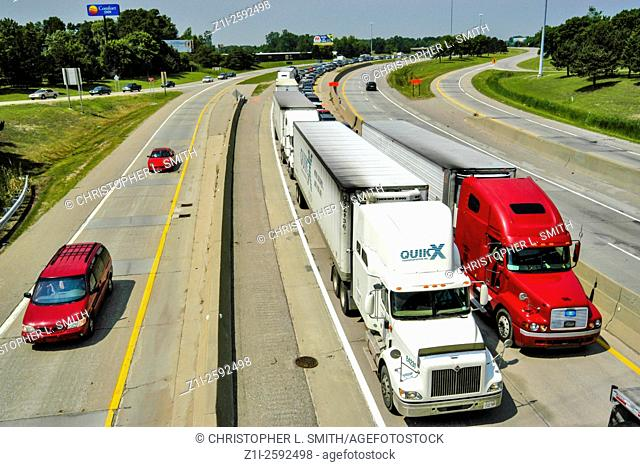 Trucks in two lanes of an Interstate junction where congestion is an every day situation
