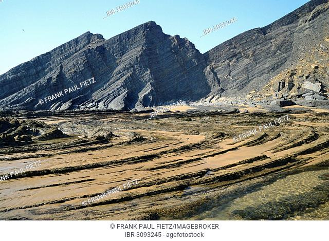 Rock formations on the beach, Atlantic coast, Praia da Amoreira beach, Aljezur, Faro District, Portugal