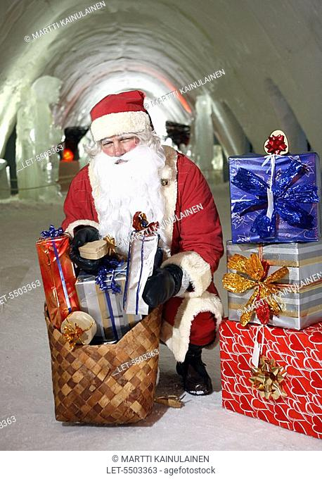 Santa Claus with Christmas presents in the SnowCastle of Kemi