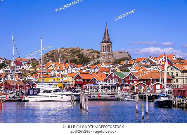 Overlooking the waterfront and the church of the fishing village of Fjallbacka in Bohuslan county, Sweden, being famous by the crime stories of the Swedish...