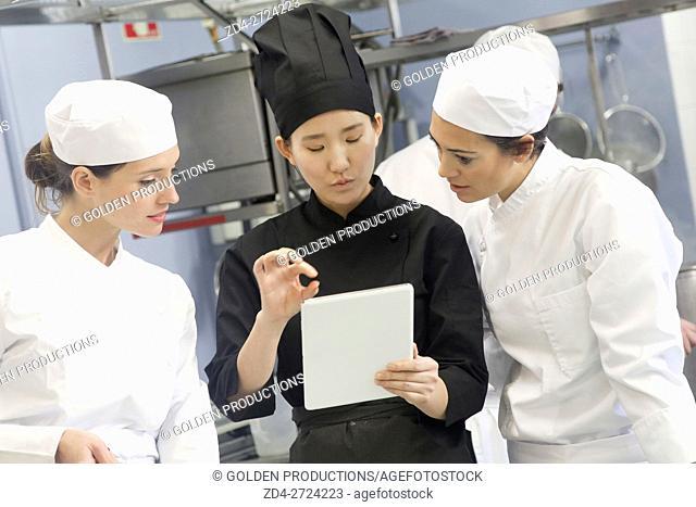 Chefs preparing menu in restaurant kitchen
