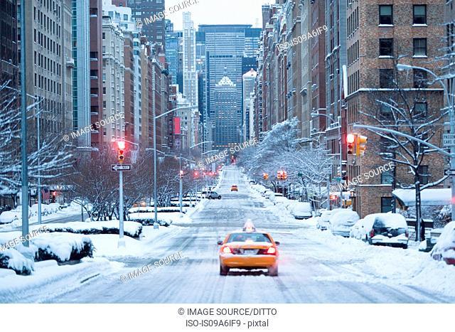 Taxi on snowy city street